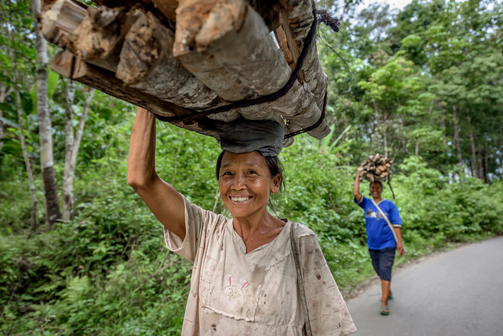 Women in Aek Banir village near Batang Gadis National Park, Mandailing Natal, North Sumatra, carry home firewood from the forest on their heads